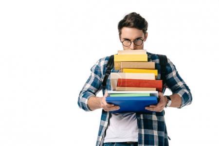 Photo pour Beau étudiant regardant à partir de pile de livres isolés sur blanc - image libre de droit