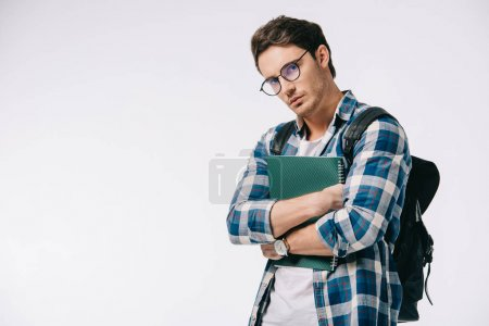 serious handsome student looking at camera isolated on white