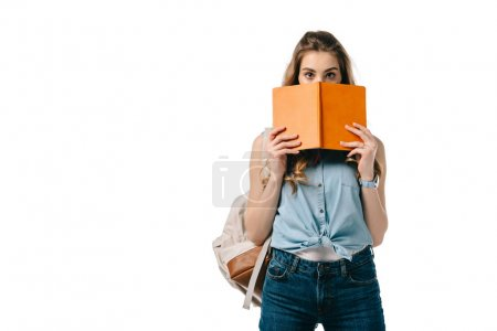 beautiful student looking out from book isolated on white