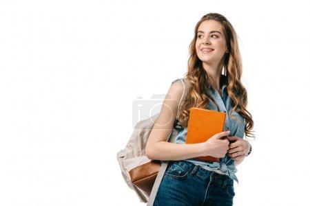 Photo pour Magnifique étudiant tenant livre et regardant loin isolé sur blanc - image libre de droit