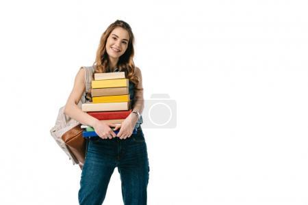 smiling beautiful student holding stack of books isolated on white