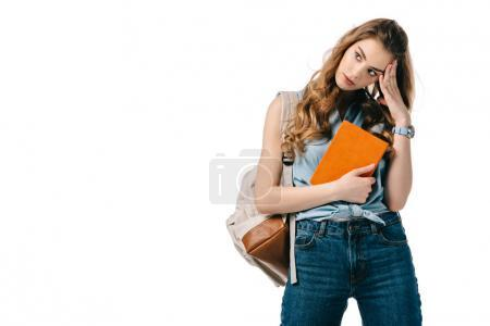 beautiful tired student with book isolated on white