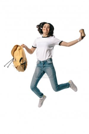 happy african american teen student jumping with disposable coffee cup isolated on white