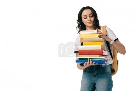 african american teen student looking at books isolated on white