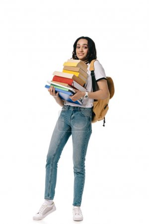 african american teen student holding heavy stack of books isolated on white