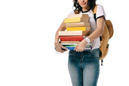 imagen recortada de afroamericano adolescente estudiante celebración pila de libros aislados en blanco