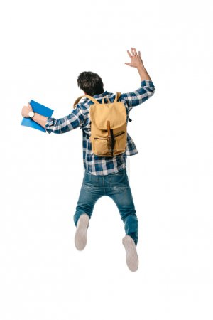 back view of student jumping with backpack and copybook isolated on white