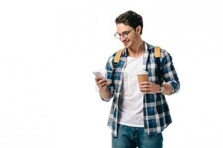 handsome student using smartphone and holding coffee isolated on white