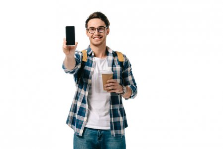 Photo for Handsome student showing smartphone isolated on white - Royalty Free Image