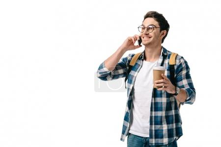Photo for Smiling handsome student talking by smartphone isolated on white - Royalty Free Image