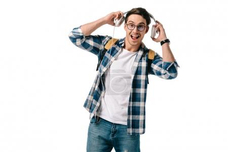 happy handsome student listening to music isolated on white