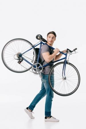 handsome student holding bicycle on shoulder isolated on white