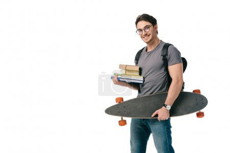 happy handsome student holding books and skate isolated on white