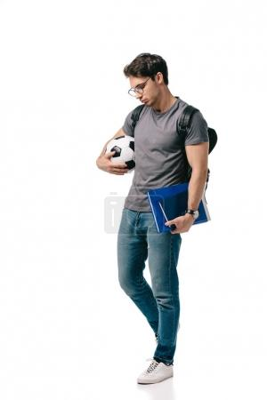 sad handsome student holding football ball isolated on white