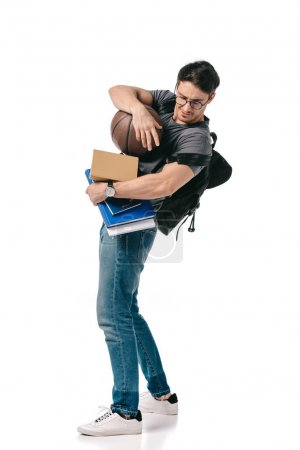 handsome student with books and basketball ball on white