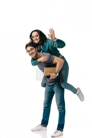 caucasian boyfriend giving piggyback to african american girlfriend and she waving hand isolated on white