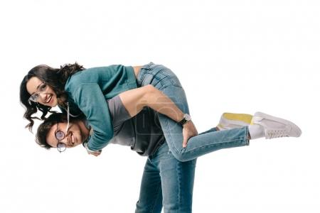 caucasian boyfriend giving piggyback to african american girlfriend isolated on white