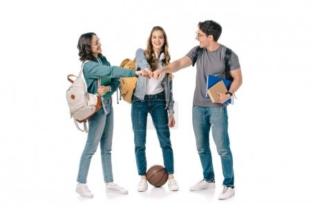 happy multicultural students making fist bump on white