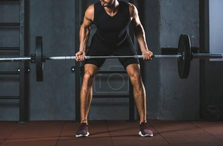 Photo for Cropped image of athlete holding barbell in sports hall - Royalty Free Image