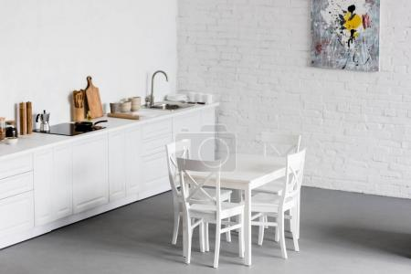 white dining table at modern kitchen with white brick walls