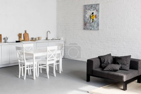 Photo for Dining table on kitchen at modern studio apartment - Royalty Free Image