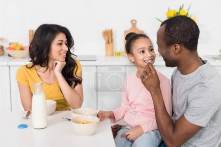 happy young family spending time on kitchen together