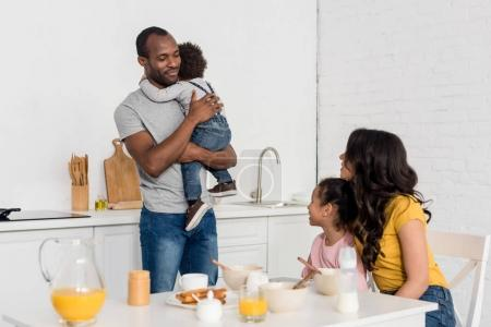 happy young family at kitchen in morning