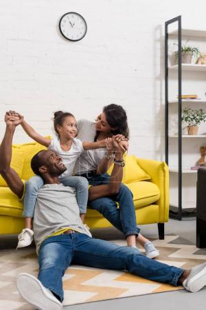 happy african american family spending time together at home