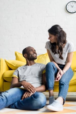 Photo for Young african american couple spending time together at living room - Royalty Free Image