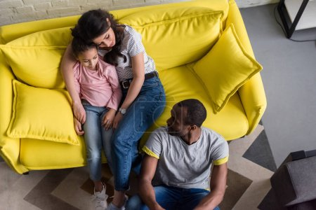 top view of happy young family relaxing at living room