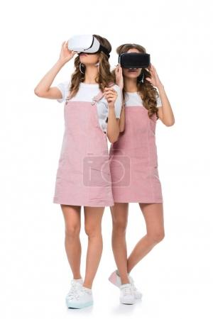 young twins in virtual reality headsets isolated on white
