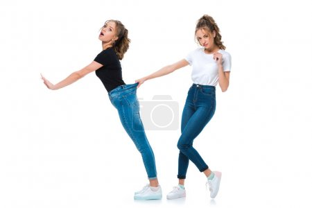 attractive young twins having fun isolated on white