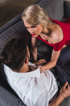 overhead view of seductive stylish couple looking at each other in foreplay