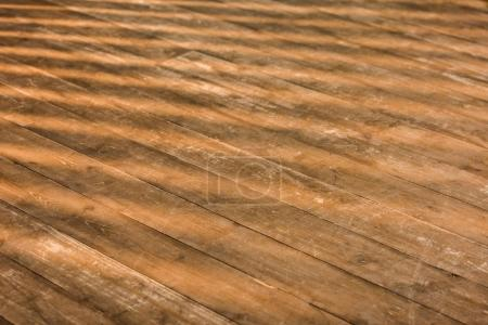 close up view of brown wooden floor as background