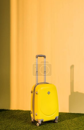 yellow travel bag on floor at home