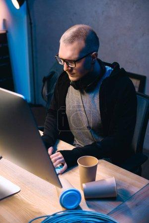 serious young hacker developing malware