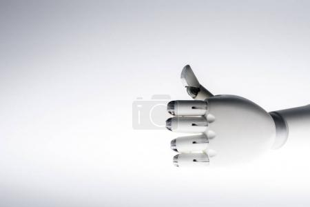 robot hand showing thumb up isolated on grey