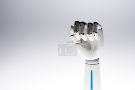 robot hand showing fist isolated on grey