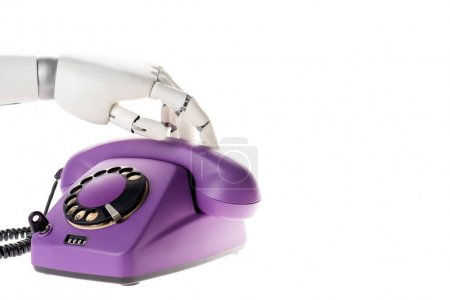 Photo pour Robot toucher main ultra violet rétro téléphone fixe isolé sur blanc - image libre de droit