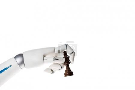 robot hand holding chess king figure isolated on white