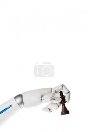 robot hand holding black chess king figure isolated on white