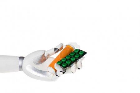 Photo pour Robot main tenant bouteille et blister avec des pilules isolées sur blanc - image libre de droit