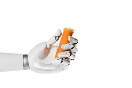 robot hand holding bottle of pills isolated on white