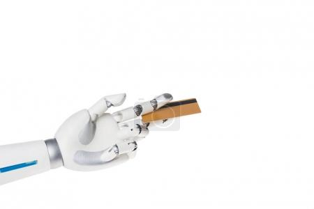 robot hand holding credit card between fingers isolated on white