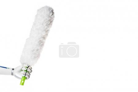 robot hand holding white dust brush for cleaning isolated on white
