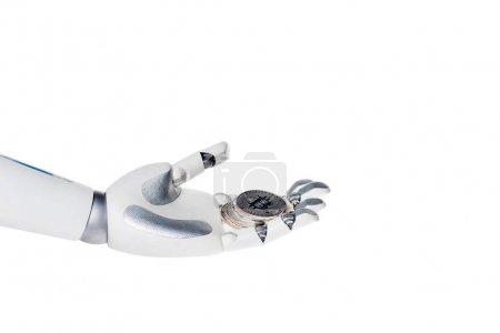 Photo pour Main de robot sur bitcoin isolé sur blanc - image libre de droit