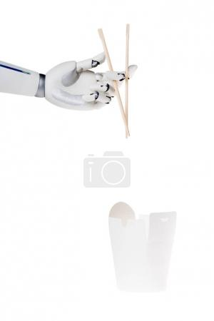 robot hand holding chopsticks above paper box with noodles isolated on white