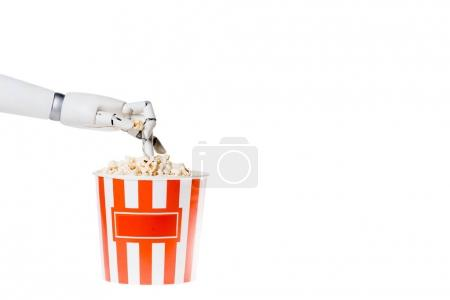 cropped shot of robot taking popcorn out of bucket isolated on white