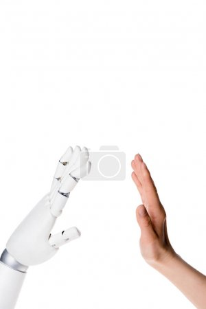cropped shot of robot and human making high five gesture isolated on white