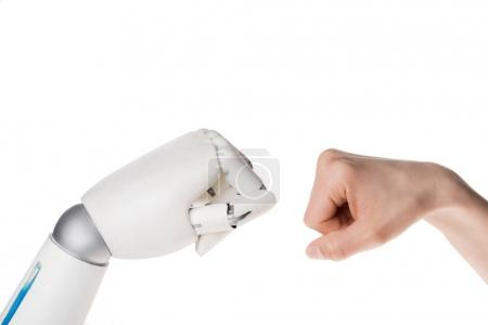 cropped shot of robot and human making bro fist gesture isolated on white